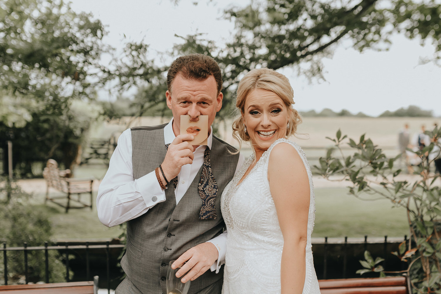 Image of an Essex funfair wedding at Old Brook Barn in Romford near London with fun wedding photographs taken by Essex wedding photographer Kelsie Low Photography.