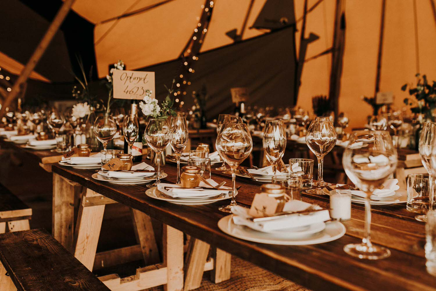 Image containing wedding photography of an Essex tipi wedding at The Barns at Lodge Farm in Nazeing, Essex.