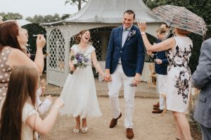 Image of a wedding at Marks Hall in Coggeshall near Colchester by wedding photographer in Essex, photographing a fun, relaxed barn Essex wedding on a rainy day.