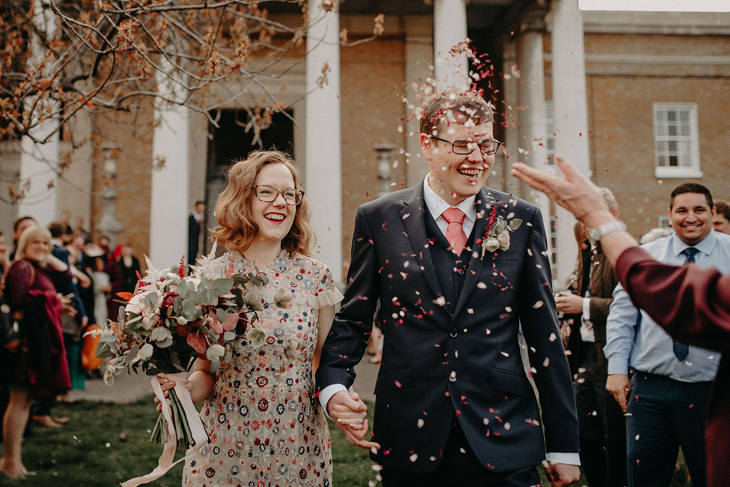 Groom getting confetti thrown in his face on wedding day at The Asylum